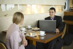 Couple of Business People at the Table Royalty Free Stock Photo