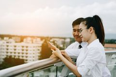 Couple business people using smartphone together. stock photos