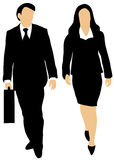 Couple of business people walking forward. Male and female business people on white background walking forward, the man holding a briefcase Royalty Free Stock Photos