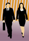 Couple of business people walking forward. Male and female business people on striped colorful background walking forward, the man holding a briefcase Royalty Free Stock Images