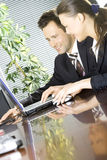 A couple of business people working Royalty Free Stock Image