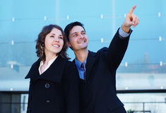 A couple of business persons in formal clothes Royalty Free Stock Photography