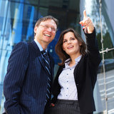 A couple of business persons in formal clothes Stock Photography