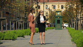 Couple of business women taking conversation on the street of the city. stock footage