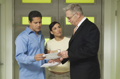 Couple And Businessman With Documents royalty free stock photos