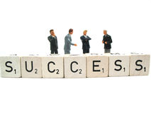 A couple of businessmen in action. A couple of businessmen behind the word succes stock photo