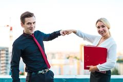 Couple of businessmen, young brunette man and young beauty blond Royalty Free Stock Images