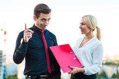 Couple of businessmen, young brunette man and young beauty blond Stock Photography