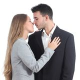 Couple of businesspeople in love ready to kiss. Isolated on a white background Royalty Free Stock Photo