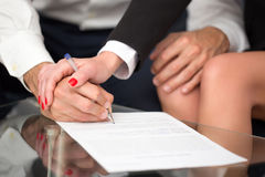 Couple or businesspeople signing contract closeup Stock Photo