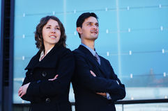 A couple of businesspersons in formal clothes Stock Images