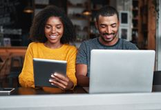 Couple busy in using electronic devices at café royalty free stock photo