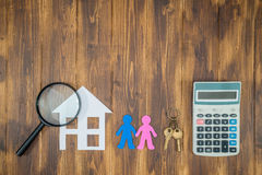Couple buy house Mortgage calculations, calculator with Magnifier. Searching royalty free stock photography
