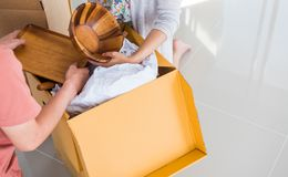 Couple buy a new home. Moving appliance stock photo