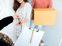 Couple buy a new home. Moving into house. Couple buy a new home. Sign contact and get a key stock image