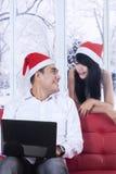 Couple buy online christmas gift Stock Photography