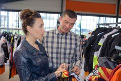 Couple buying accessories for motorbike Stock Photo