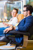 Couple buying armchair in furniture store Royalty Free Stock Photo