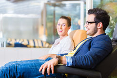 Couple buying armchair in furniture store Stock Photography