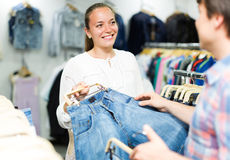 Couple buying blue jeans at store Stock Photo