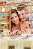 Couple buying bracelet in jewelry Stock Images