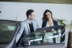 Couple buying a car Stock Images