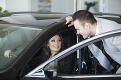 Couple buying a car Royalty Free Stock Image