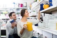 Couple buying ceramic Stock Images