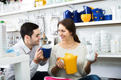 Couple buying ceramic. Happy young couple buying ceramic ware in the shop Royalty Free Stock Images