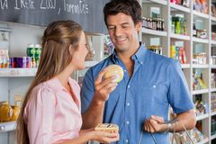 Couple Buying Cheese In Store Royalty Free Stock Photos