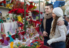Couple buying Christmas flower at market Royalty Free Stock Photos