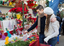 Couple buying Christmas flower at market Royalty Free Stock Images