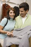 Couple Buying Clothes In Store Stock Image