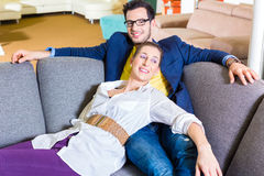 Couple buying couch in furniture store Stock Photo