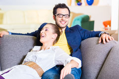 Couple buying couch in furniture store Stock Photography