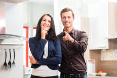 Couple buying domestic kitchen furniture store Stock Photo