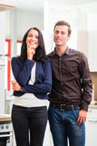Couple buying domestic kitchen furniture store. Man and women buying domestic kitchen in studio or furniture store Stock Image
