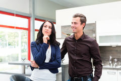 Couple buying domestic kitchen furniture store Royalty Free Stock Photos