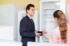 Couple buying domestic refrigerator Stock Image