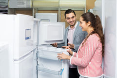 Couple buying domestic refrigerator Stock Image