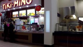 Couple buying food at food court stock video footage