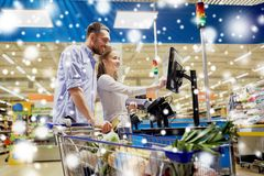 Couple buying food at grocery self-checkout. Shopping, sale, payment, consumerism and people concept - happy couple with bank card buying food at grocery store Royalty Free Stock Photos