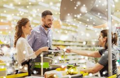 Couple buying food at grocery store cash register Stock Image