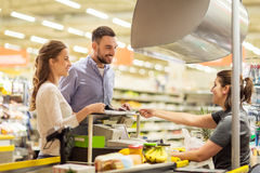 Couple buying food at grocery store cash register Royalty Free Stock Images
