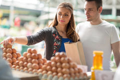 Free Couple Buying Fresh Eggs At Farmer's Market Royalty Free Stock Photography - 87367707