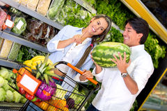 Couple buying fresh fruits Royalty Free Stock Photo