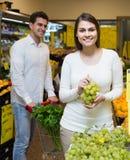 Couple buying fresh seasonal fruits in market Royalty Free Stock Image