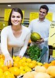 Couple buying fresh seasonal fruits in market Stock Photo