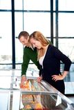 Couple Buying Frozen Pizza Royalty Free Stock Photo