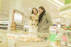 Couple buying fruits Stock Photography